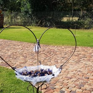 The confetti umbrellas in front of the Chapel at Benedetto On Vaal Venue during Dwaine and Inge-Mari wedding