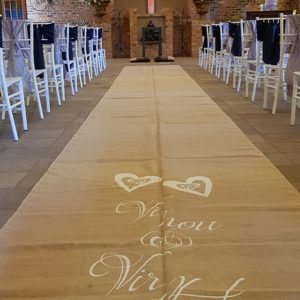 A custom runner at Dwaine and Inge-Mari wedding inside the Chapel at Benedetto On Vaal Venue