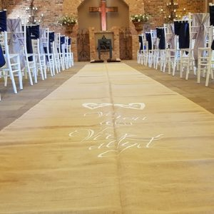 Another view of the custom runner at Dwaine and Inge-Mari wedding inside the Chapel at Benedetto On Vaal Venue