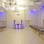 A wide view of the reception hall at Dylan and Carla's Wedding at Benedetto On Vaal Venue