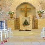 A view looking forward inside the chapel at Dylan and Carla's Wedding at Benedetto On Vaal Venue