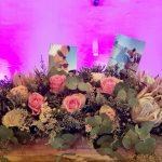 The main table flower arrangements at Bona Bona Game Lodge on Emily and Nicholas's Wedding