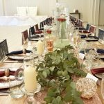 A view of the table settings at Dylan and Carla's Wedding at Benedetto On Vaal Venue